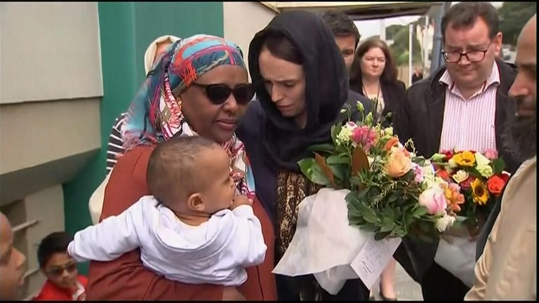 New Zealand prime minister Jacinda Ardern (right) comforts one of the bereaved
