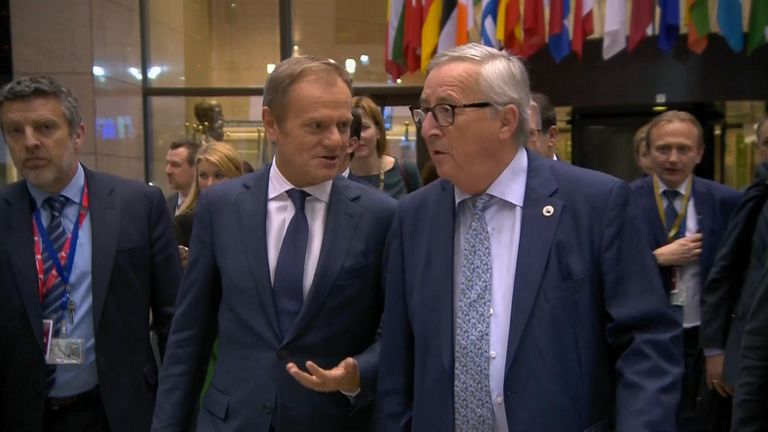 Jean-Claude Juncker and Donald Tusk chat before presser.
