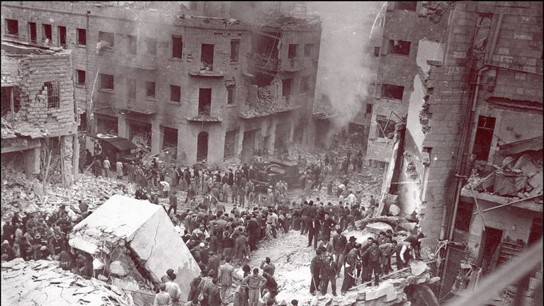 Jewish rescuers search for victims among the rubble of destroyed buildings in Jerusalem during the 1948 war