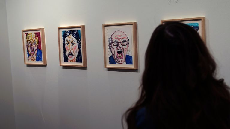 People view Jim Carrey's artwork during the Outsider Art Fair in New York