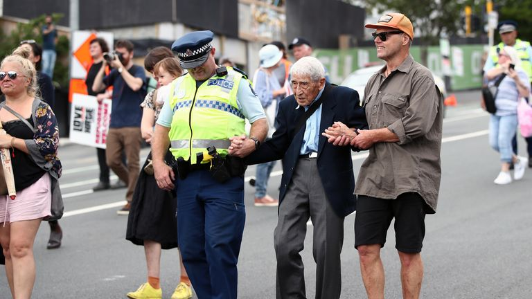 The Second World War veteran was helped by a police officer and supporter at the march