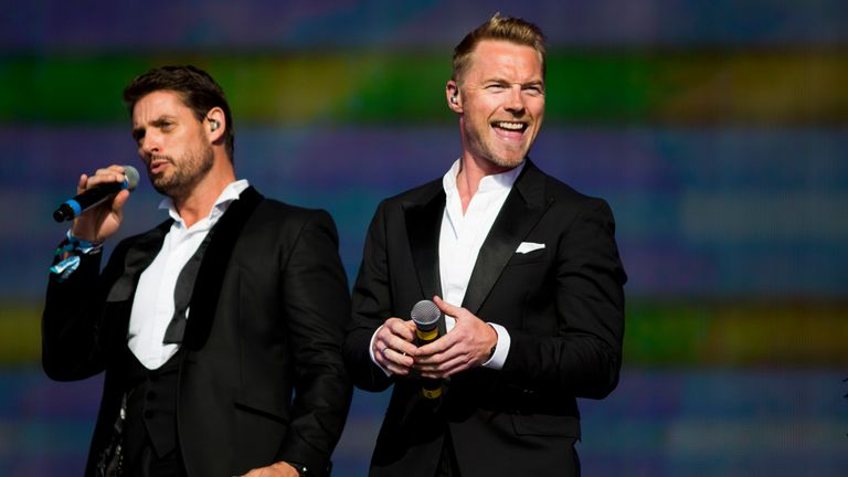(L-R) Keith Duffy and Ronan Keating of Boyzone perform on stage