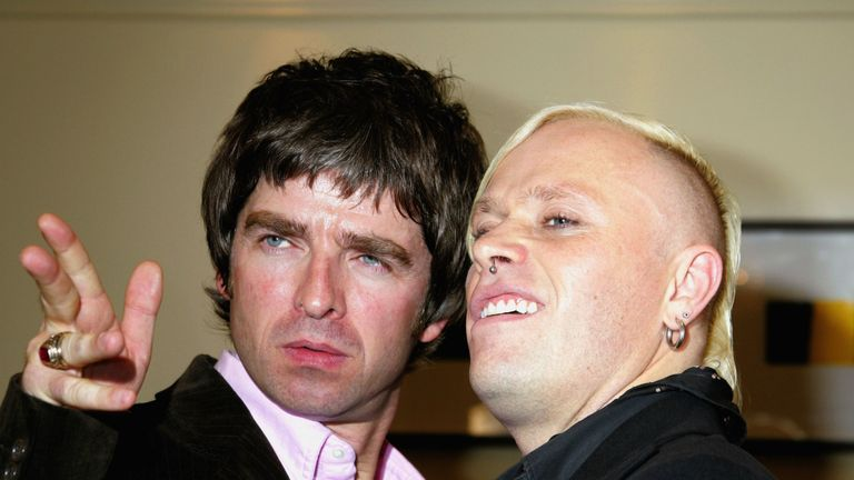 "LONDON - OCTOBER 10:  Noel Gallagher and Keith Flint pose in the awards room after Oasis win the Peoples Choice and Best Album award for ""Don't Believe The Truth"", and The Prodigy win the Q Innovation In Sound award at The Q Awards, the annual magazine's music awards, at Grosvenor House on October 10, 2005 in London, England.  (Photo by Jo Hale/Getty Images) *** Local Caption *** Noel Gallagher;Keith Flint"