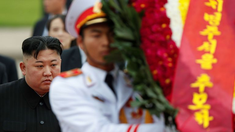 North Korean leader Kim Jong Un (L) attends a wreath laying ceremony at the Ho Chi Minh mausoleum in Hanoi on March 2, 2019