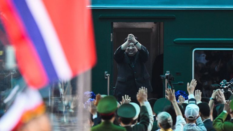North Korea's leader Kim Jong Un (C) waves before boarding his train at the Dong Dang railway station in Lang Son on March 2, 2019