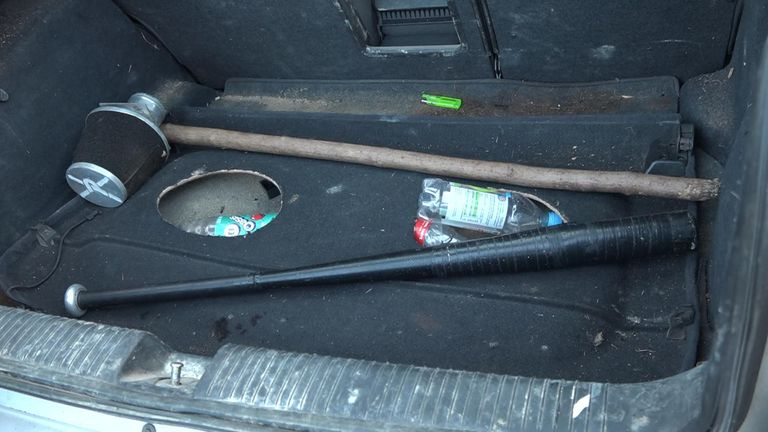 A baseball bat and wooden pole were found in the boot