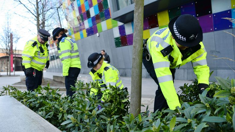 Officers from the Metropolitan Police search for knives outside in Lewisham, south London,  as part of Operation Sceptre