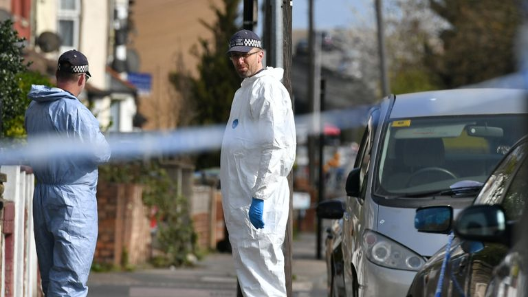 Forensics officers at the scene of one of the four stabbings in north London