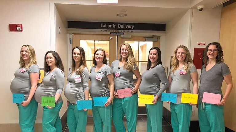 Eight of the nine pregnant nurses posed for a photo on the labour ward. Pic: Maine Medical Centre/Facebook