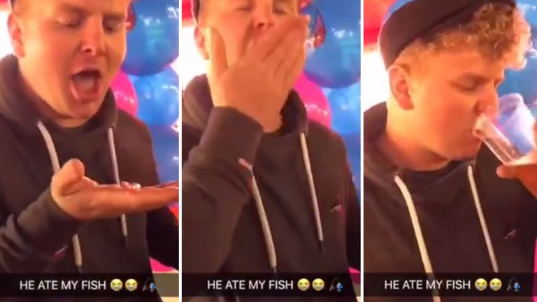 Joshua Coles swallowing a goldfish at Bridgwater Fair in Somerset