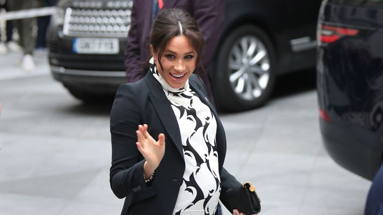 The Duchess of Sussex leaves after a panel discussion convened by The Queen's Commonwealth Trust to mark International Women's Day
