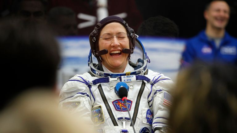 NASA astronaut Christina Koch reacts as her spacesuit is tested