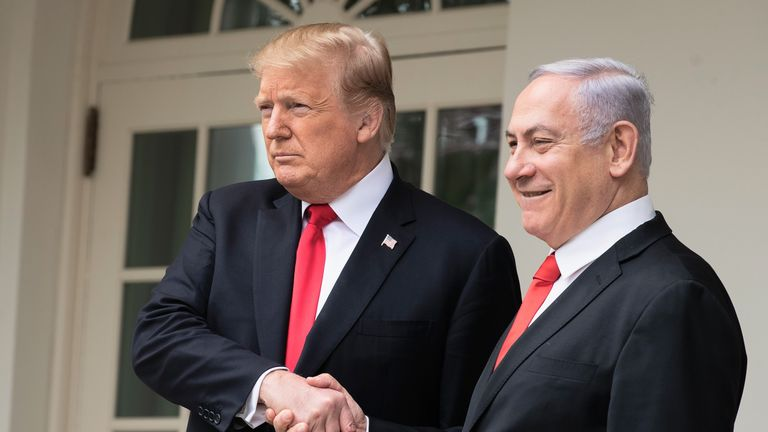 U.S. President Donald Trump and Prime Minister of Israel Benjamin Netanyahu shake hands while walking through the colonnade prior to an Oval Office meeting at the White House March 25, 2019 in Washington, DC