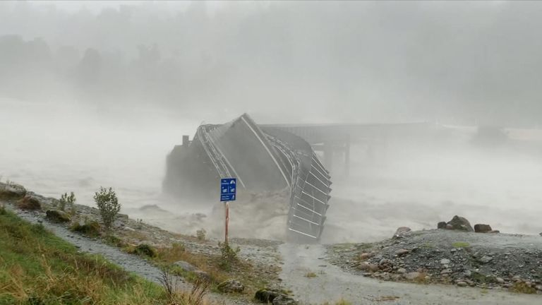 Raging storm sweeps away bridge