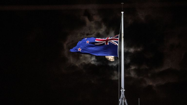 The New Zealand national flag is flown at half-mast on a Parliament building in Wellington