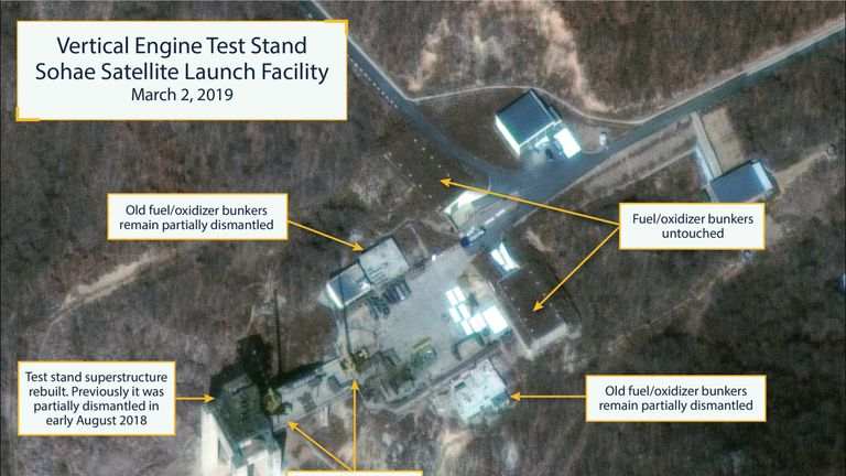 Image showing North Korean rocket launch site restoration at Sohae (Tongchang-ri). The vertical engine test stand as seen on March 2, 2019 showing the stand partially rebuilt. Among the notable items visible are two construction cranes, several vehicles and supplies laying on the ground. (Copyright © 2019 by DigitalGlobe)