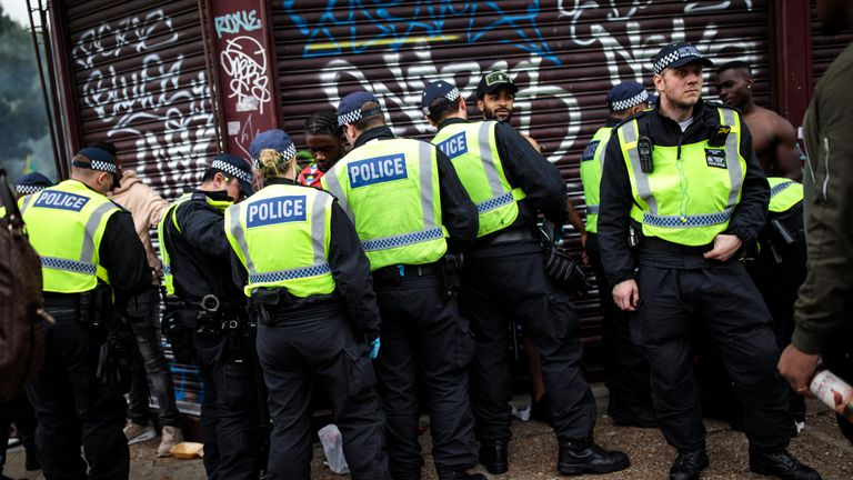 Police officers stop and search people on the final day of the Notting Hill Carnival on August 27, 2018 in London, England