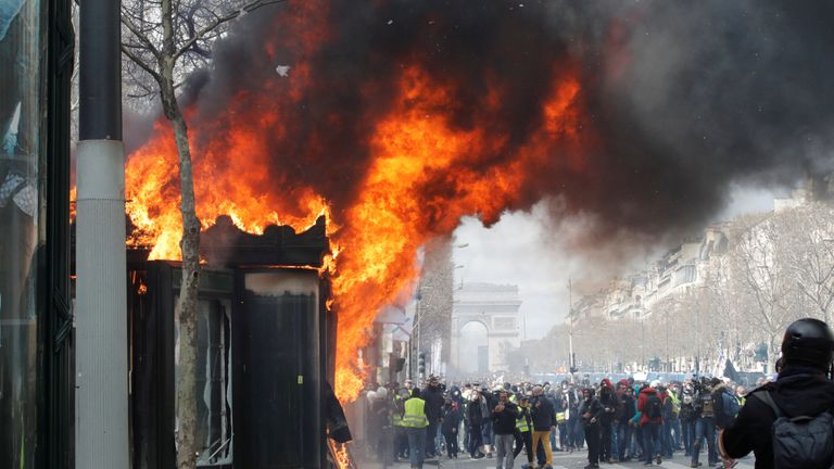 "A burning newsagent's shop is seen during a demonstration by the ""yellow vests"" movement in Paris, France, March 16, 2019."