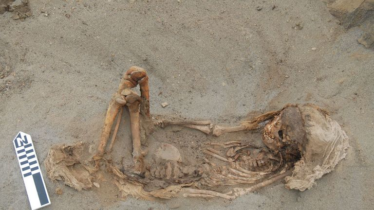 A typical child burial laying on its back with the legs flexed - from PLOS research at Pery mass grave. Pic: PLOS