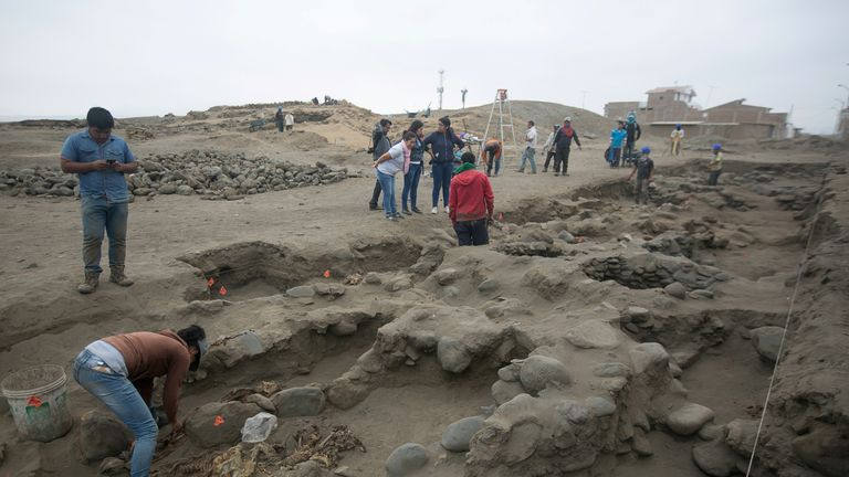 Archaeologists unearth a mass grave of children and adults from the Chimu culture at Pampa La Cruz in Huanchaco district of Trujillo, Peru, June 2018