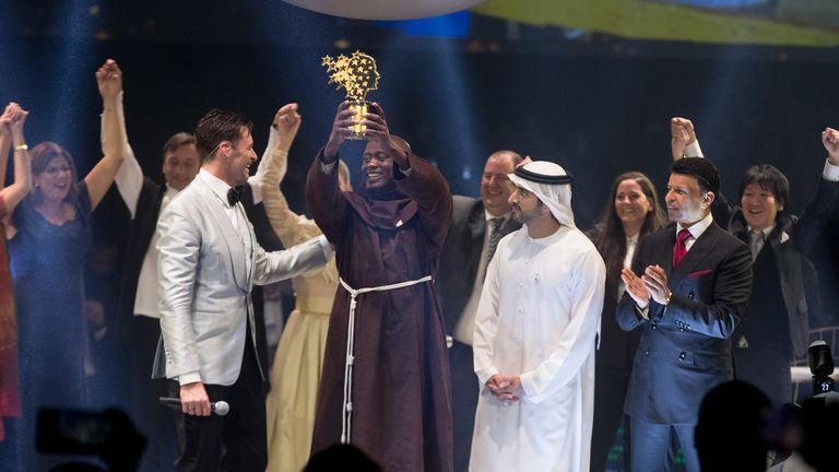 Peter Tabichi received his award from actor Hugh Jackman. Pic: The Varkey Foundation