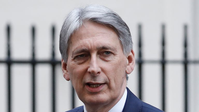 Chancellor Philip Hammond leaves after attending the weekly cabinet meeting at 10 Downing Street