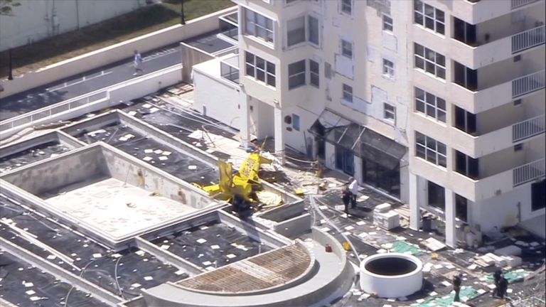 The impact left a hole in the building before the plane fell into a construction zone, one local report said.