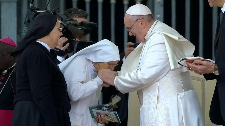 Pope accepting kisses from nuns at the Vatican