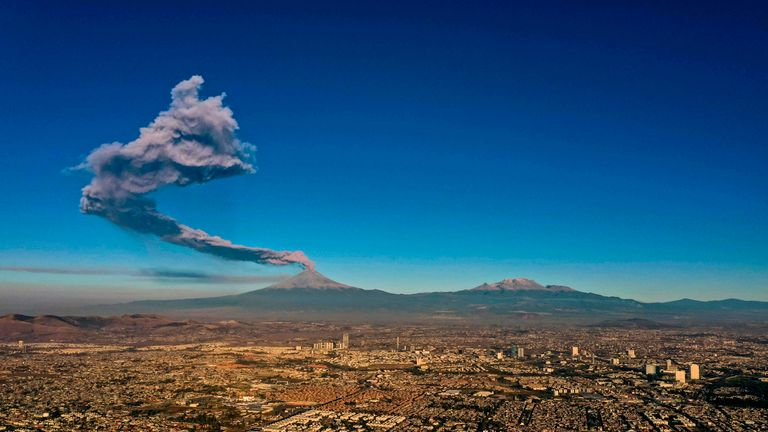 The Popocatepetl Volcano spews ash