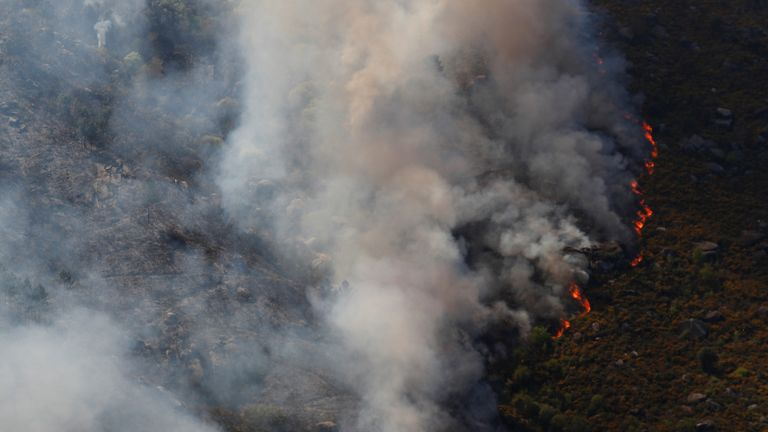 Flames of an approaching forest fire near small village of Gondomil, near Valenca, Portugal