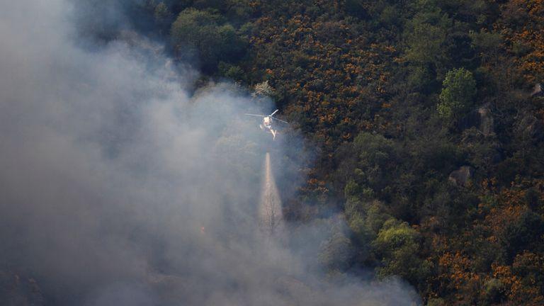 An approaching forest fire near small village of Gondomil, near Valenca, Portugal