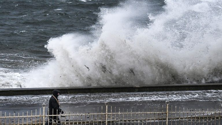Members of the public look on as Storm Erik makes landfall with winds of up to 70mph due to hit some areas of the UK along with heavy rain on February 8, 2019 in Prestwick, Scotland