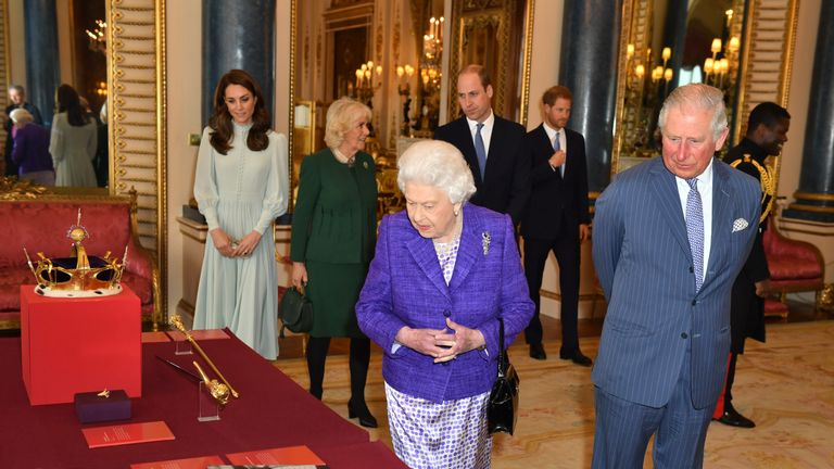 Queen Elizabeth II is joined by the Prince of Wales, at a reception at Buckingham Palace in London to mark the fiftieth anniversary of the investiture of the Prince of Wales.
