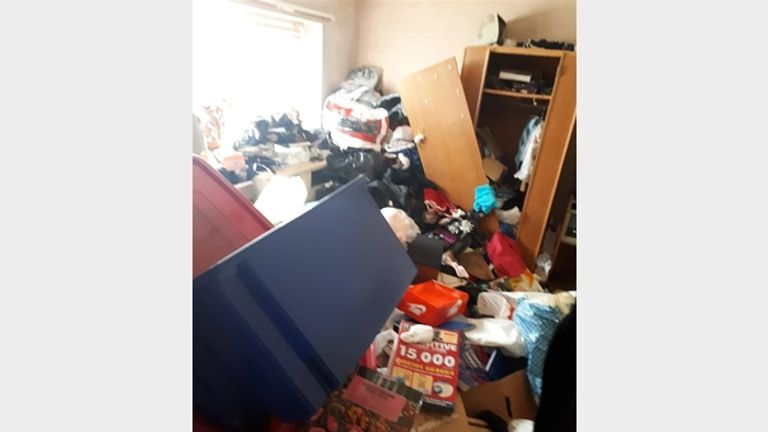 The property in Quinton comes complete with mounds of rubbish. Pic: Bagshaws Residential