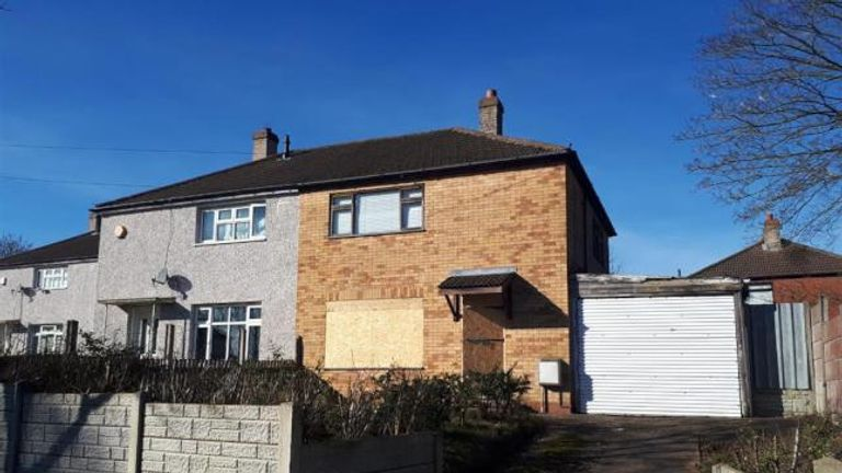 The house in Quinton has one of its ground floor windows boarded up. Bagshaws Residential