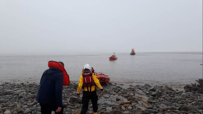 A coastguard helicopter and five lifeboats went searching for the sailors