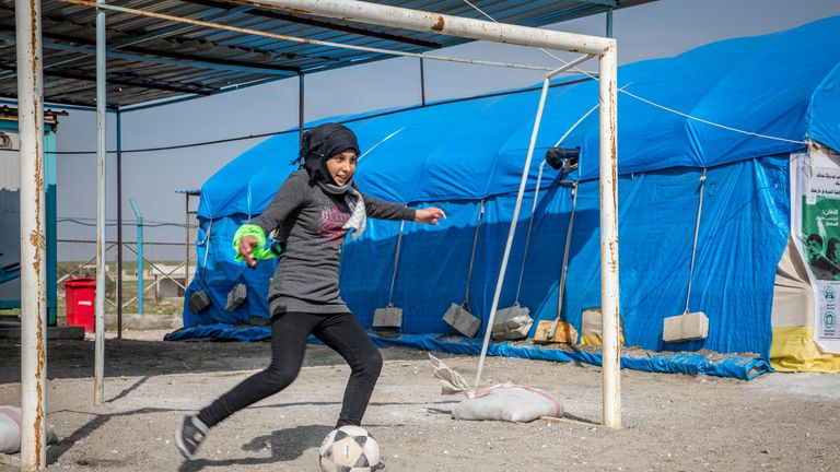 Sara, 14, plays in goal during a football match at Save the Children's child friendly space in Ein Issa camp, Syria