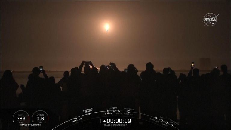 Spectators watch the launch from Florida's Kennedy Space Centre