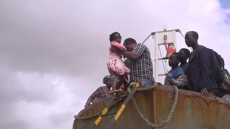 No aid, no government - just a rusty fishing boat to flee Cyclone Idai carnage