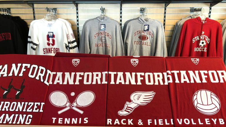 Shirts with the Stanford University logo at the Stanford Athletics Shop on March 12, 2019 in Stanford, California. More than 40 people, including actresses Lori Loughlin and Felicity Huffman, have been charged in a widespread elite college admission bribery scheme. Parents, ACT and SAT administrators and coaches at universities including Stanford, Georgetown, Yale, and the University of Southern California have been charged