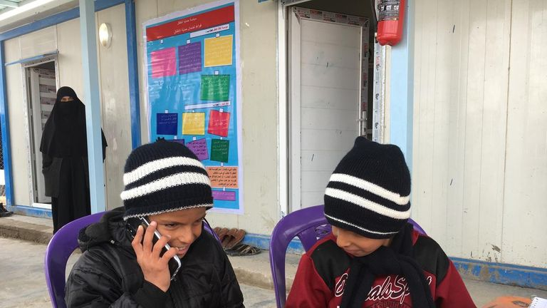 The two boys speak to their mother on the phone