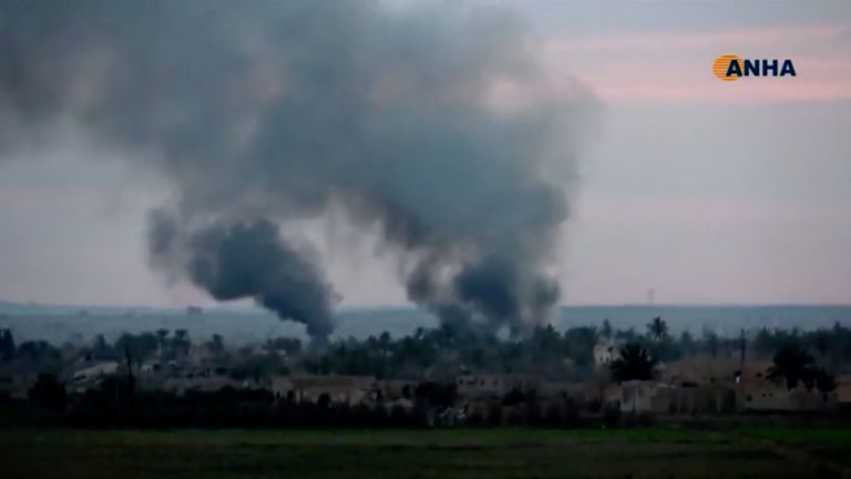 Smoke rises from a village near Baghouz, Syria as the SDF fight Islamic State militants