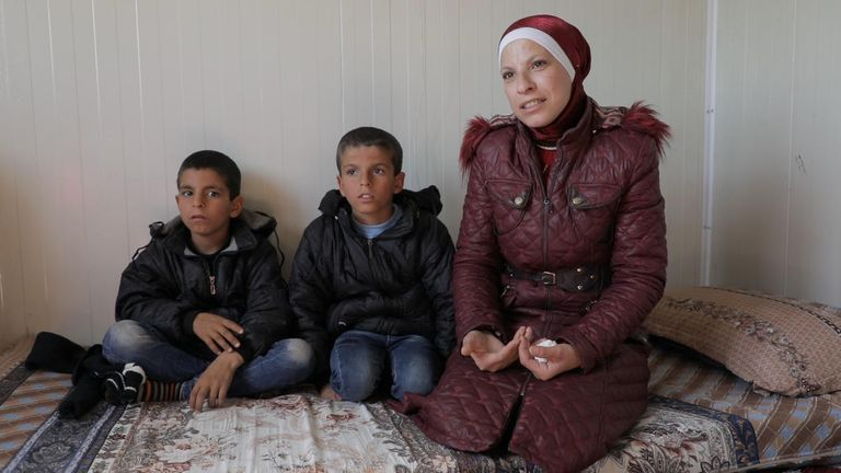 Rasha with her sons Yousef, 11, and Mohammed, nine, in a displacement camp, northeast Syria