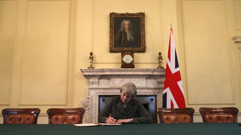Theresa May signing the official letter to Donald Tusk invoking article 50