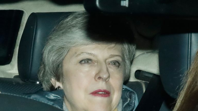 Theresa May leaves the Houses of Parliament after her Brexit deal was defeated
