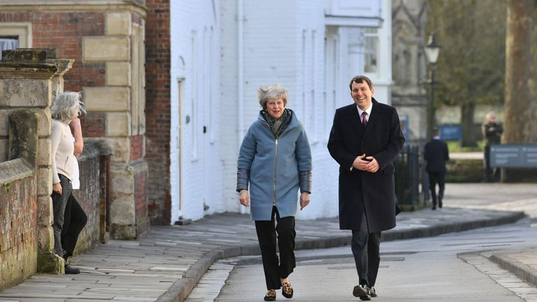 Theresa May walks through Salisbury with local MP John Glen on the first anniversary of the Skripal poisoning