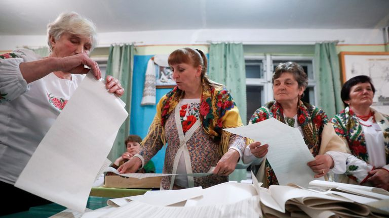 Members of a local electoral commission count votes at a polling station following a presidential election in Rohatyn in Ivano-Frankivsk Region, Ukraine March 31, 2019