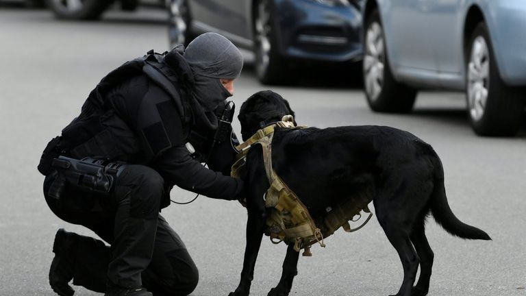 A police officer with a service dog in Utrecht, Netherlands
