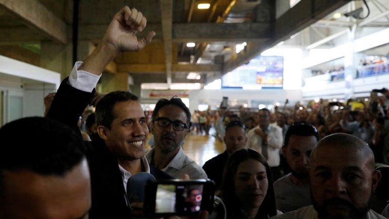 Venezuelan opposition leader Juan Guaido, who many nations have recognized as the country's rightful interim ruler, greets supporters after his arrival at the Simon Bolivar International airport in Caracas, Venezuela March 4, 2019