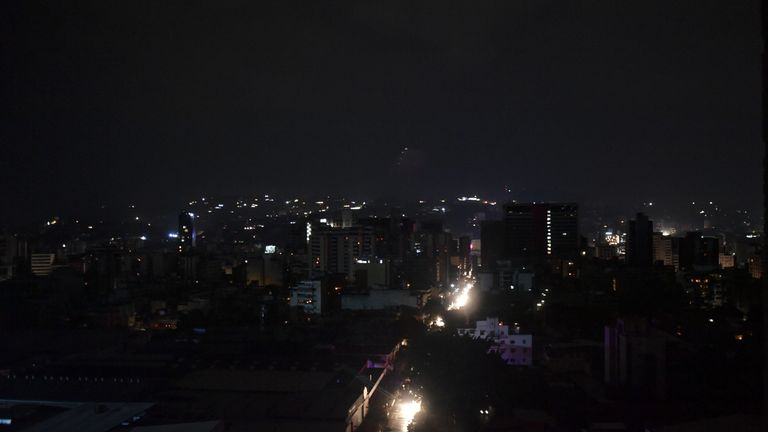 Only  a few lights remained in the bustling city of two million